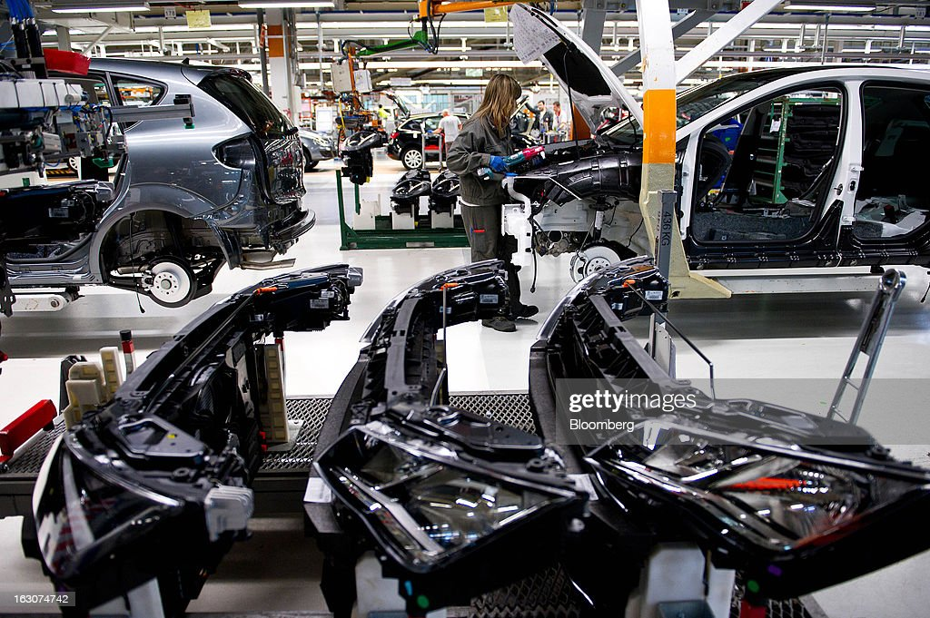 Front radiator and light units for Seat Altea XL automobiles sit before assembly on the production line at the headquarters of Seat SA in Martorell, Spain, on Thursday Feb. 28, 2013. Seat will invest 300 million euros a year in the next five years and renew its range of models, Efe said, citing an interview with James Muir, head of the Spanish unit of Volkswagen AG. Photographer: David Ramos/Bloomberg via Getty Images