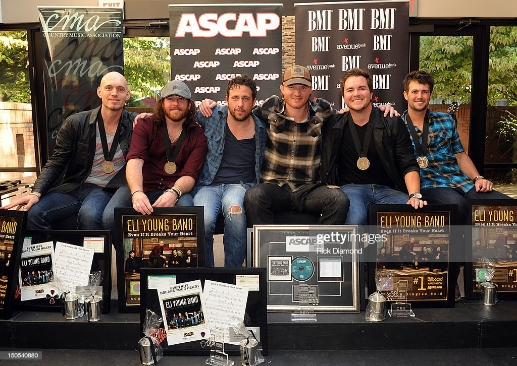 <a gi-track='captionPersonalityLinkClicked' href=/galleries/search?phrase=Eli+Young+Band&family=editorial&specificpeople=5349235 ng-click='$event.stopPropagation()'>Eli Young Band</a> members Jon Jones & James Young, Songwriter Will Hoge (BMI) and Songwriter Eric Paslay (ASCAP) <a gi-track='captionPersonalityLinkClicked' href=/galleries/search?phrase=Eli+Young+Band&family=editorial&specificpeople=5349235 ng-click='$event.stopPropagation()'>Eli Young Band</a> members Mike Eli & <a gi-track='captionPersonalityLinkClicked' href=/galleries/search?phrase=Chris+Thompson+-+Batteur+am%C3%A9ricain&family=editorial&specificpeople=15384690 ng-click='$event.stopPropagation()'>Chris Thompson</a>. Are being honored for there #1 hit 'Even if it breaks your heart' Written by Will Hoge and Eric Paslay, recorded by Republic Nashville recording artists <a gi-track='captionPersonalityLinkClicked' href=/galleries/search?phrase=Eli+Young+Band&family=editorial&specificpeople=5349235 ng-click='$event.stopPropagation()'>Eli Young Band</a> at the CMA offices on August 20, 2012 in Nashville, Tennessee.