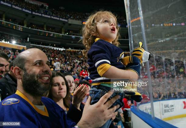 Front row fans watch the action during an NHL game between the Buffalo Sabres and Montreal Canadiens at the KeyBank Center on April 5 2017 in Buffalo...