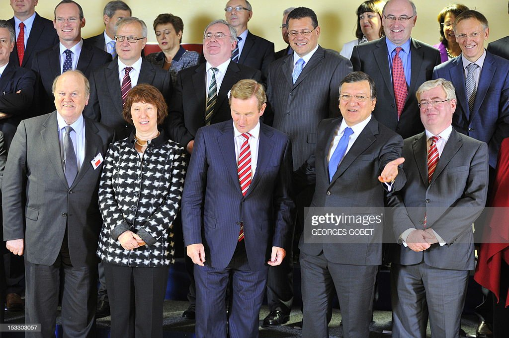 Irish Finance Minister Michael Noonan, EU foreign policy chief Catherine Ashton, Irish Prime Minister Enda Kenny, European Commission Chairman Jose Manuel Barroso and Irish Deputy Prime minister Eamon Gilmore pose on October 3, 2012 for the traditional family picture of the Irish government and the EU commissioners college at EU headquarters in Brussels. Ireland will take over the EU's six-month rotating presidency on January 1, 2013. GOBET