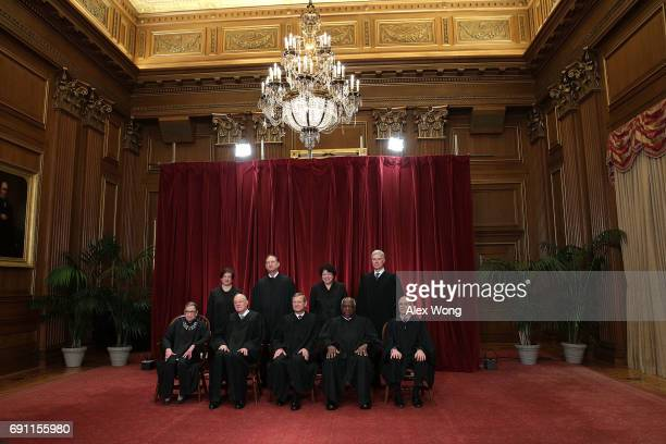 Front row from left US Supreme Court Associate Justice Ruth Bader Ginsburg Associate Justice Anthony M Kennedy Chief Justice John G Roberts Associate...