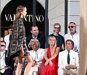 Front row Giancarlo Giammetti Gwyneth Paltrow and Valentino Garavani attend the Valentinos 'Mirabilia Romae' haute couture collection fall/winter...