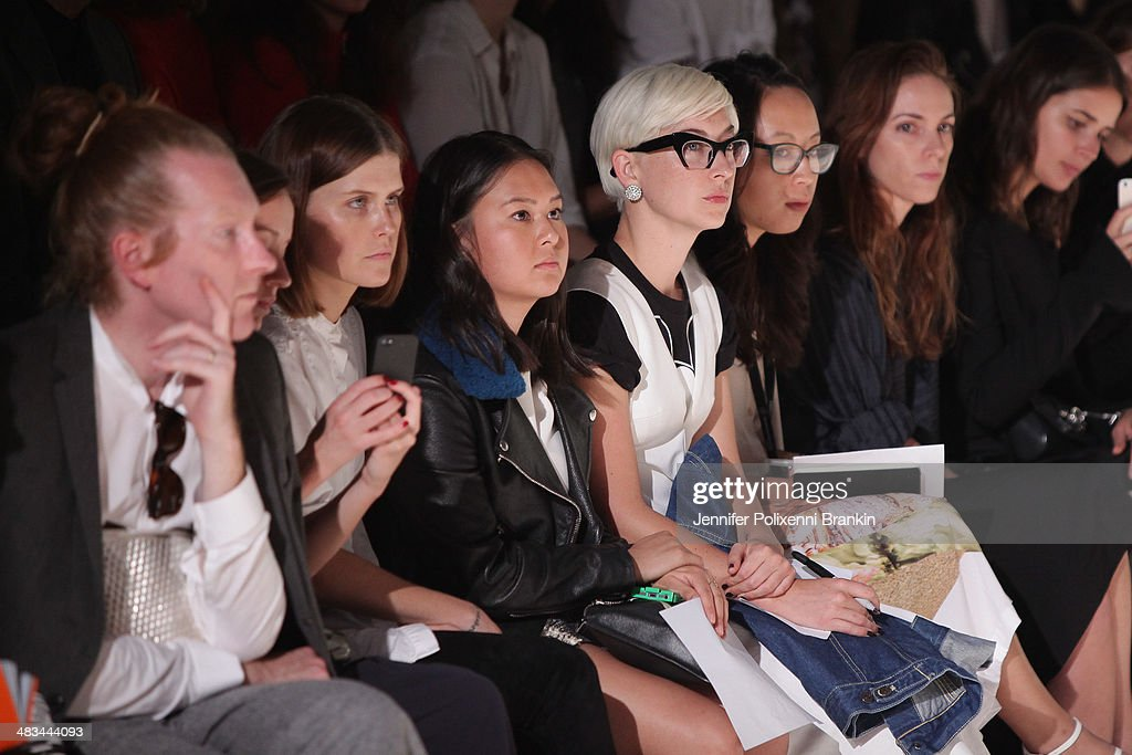 Front row guests watching the models walk during the Christopher Esber show during Mercedes-Benz Fashion Week Australia 2014 at Carriageworks on April 8, 2014 in Sydney, Australia.
