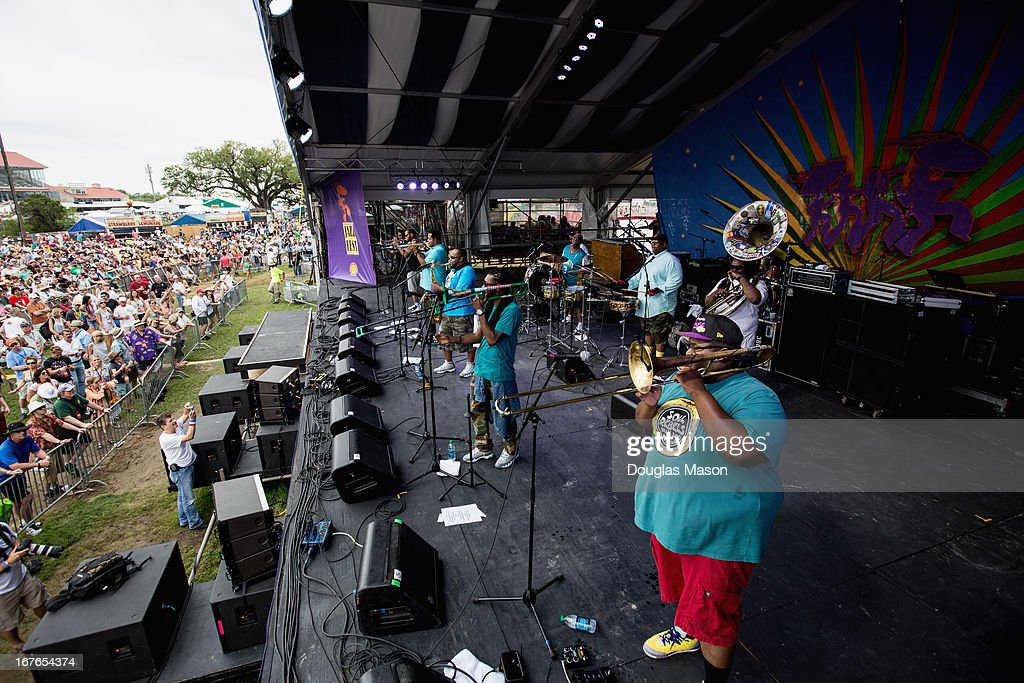 Front row (L-R) Julian Gosin, trumpet, Marcus Hubbard, trumpet, Erion Williams, sax, Corey Peyton, Trombone, Paul Robertson, Trombone. Back row (L-R) Derrick Moss, Bass drum Lumar Leblanc, Snare, Edward Lee Jr. Sousaphone The Soul Rebels Brass Band performs during the 2013 New Orleans Jazz & Heritage Music Festival at Fair Grounds Race Course on April 26, 2013 in New Orleans, Louisiana.