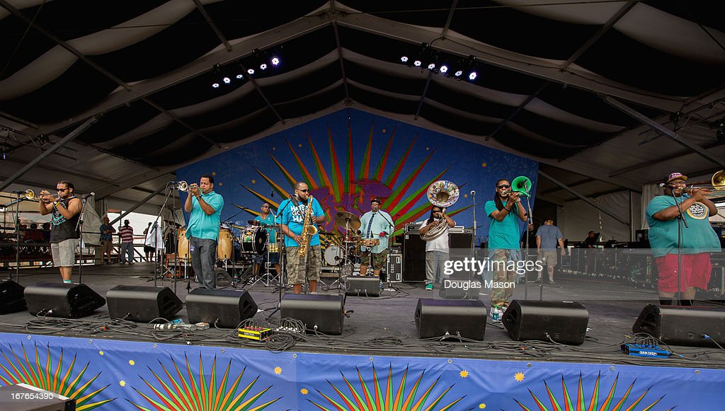 Front row (L-R) Julian Gosin, trumpet, Marcus Hubbard, trumpet, Erion Williams, sax, Corey Peyton, Trombone, Paul Robertson, Trombone. Back row (L-R) Derrick Moss, Bass drum Lumar Leblanc, Snare, Edward Lee Jr. Sousaphone. The Soul Rebels Brass Band performs during the 2013 New Orleans Jazz & Heritage Music Festival at Fair Grounds Race Course on April 26, 2013 in New Orleans, Louisiana.