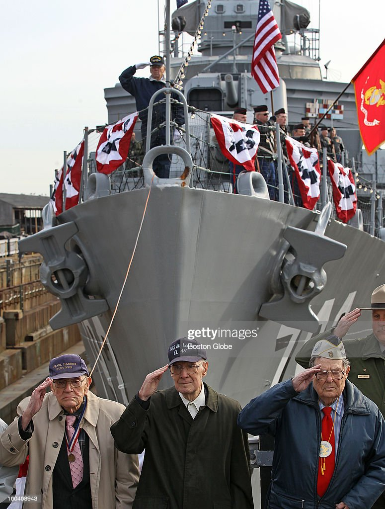 Front row of vets who were at Pearl Harbor salute the colors. From left to right: Donald Tabbut, Francis M Connolly and Gerald Halterman. Boston National Historical Park hosts a memorial service on the bow of the World War II destroyer USS Cassin Young in the Charlestown Navy Yard on Friday, Dec. 7, 2012 from 12:30 to 1:00 p.m. to commemorate the 1941 surprise attack by the Japanese on the U.S. naval base at Pearl Harbor, Hawaii. USS Cassin Young is named for U.S. Navy Commander Cassin Young who was awarded the Medal of Honor for his actions during the attack on Pearl Harbor.