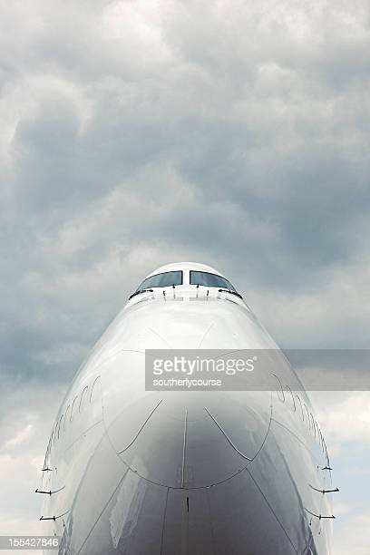 Front Section of Cargo Aircraft Against Moody Sky