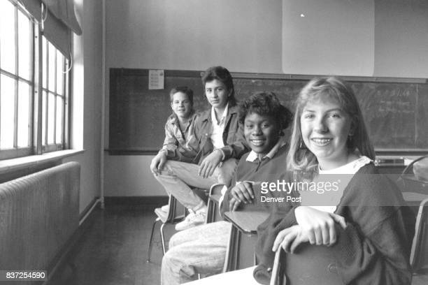 DEC 13 1987 front to rear Jennifer Dunning 16 Yam Tonya Cooper 15 Saul Fraire 16 Brian Stan 15 in a classroom at East High received awards as a...