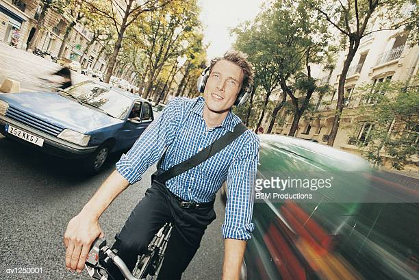 Front View of a Man Commuting in a City on a Bike