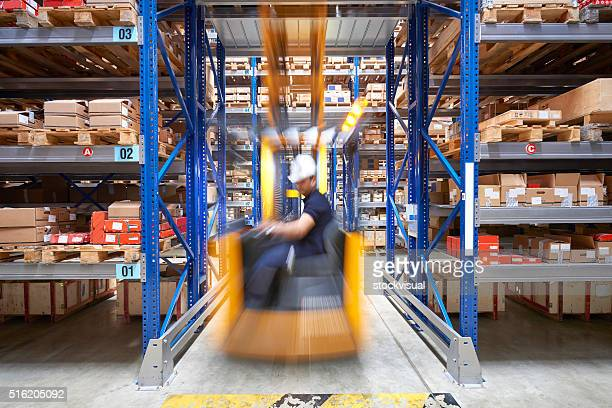 Front view of a man driving a forklift