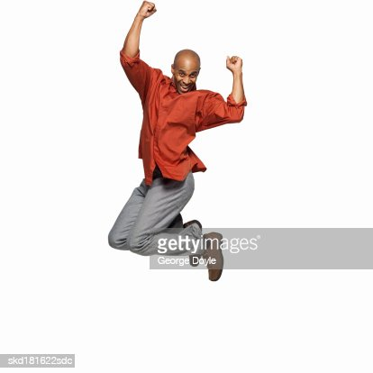 front view of a man jumping into the air : Stock Photo