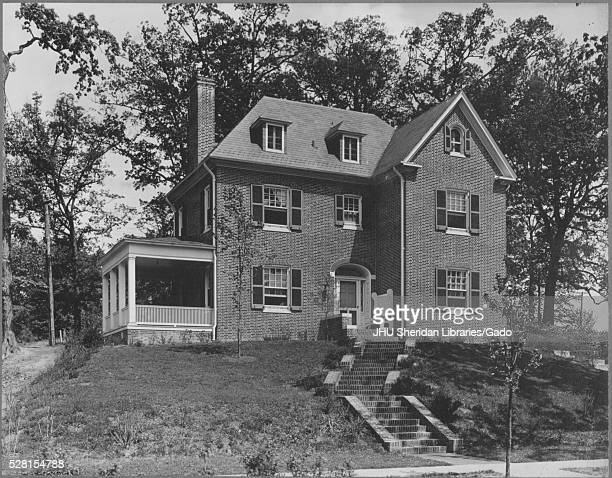 Front view of a twostory single family home near Roland Park and Guilford the house is brick with darkcolored shutters on the windows there is a...