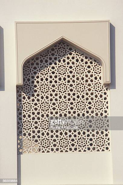 Front view of an exquisite carving seen on the white wall.