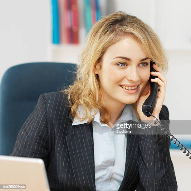 Front view of businesswoman talking on telephone