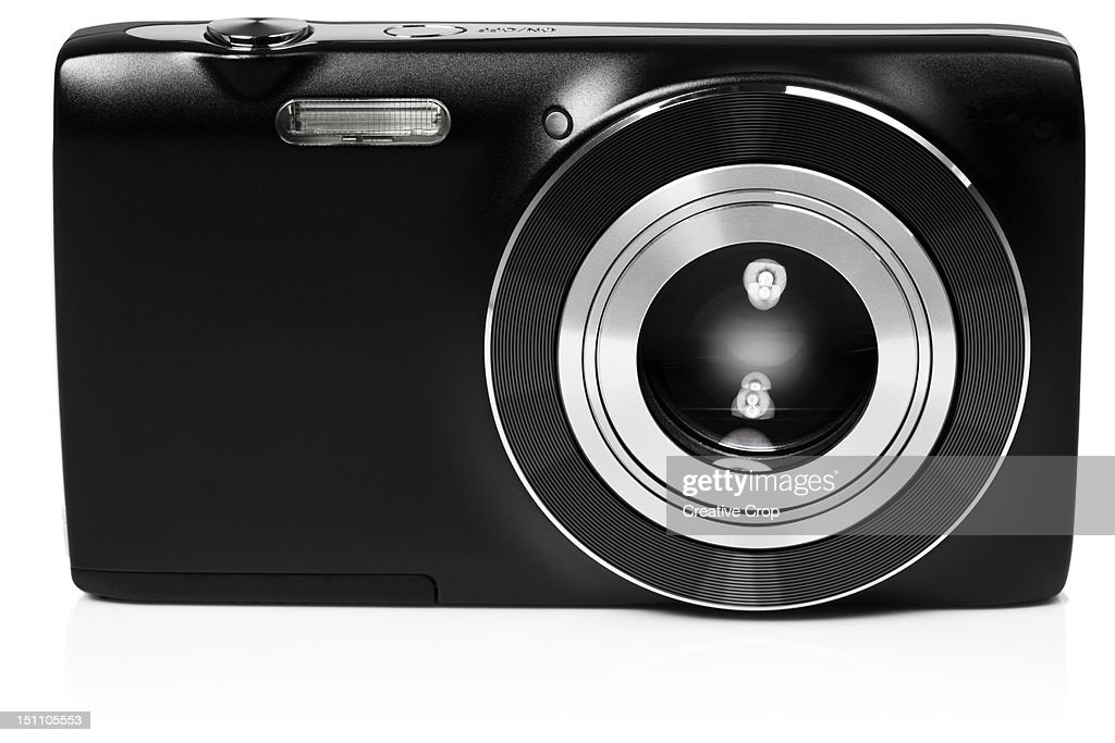 Front view of digital compact camera : Stock Photo