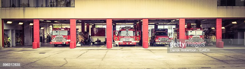 Front View Of Fire Engines In Garage