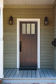 Narrow front door with porch