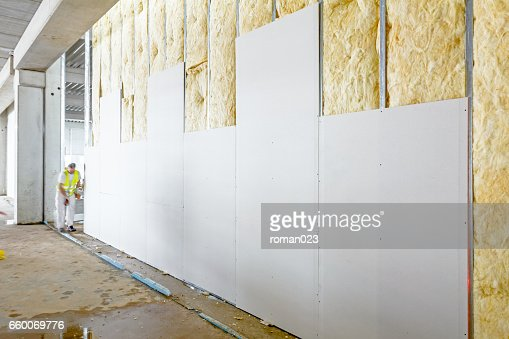 Front view of gypsum wall, plasterboard is under construction : Stock Photo