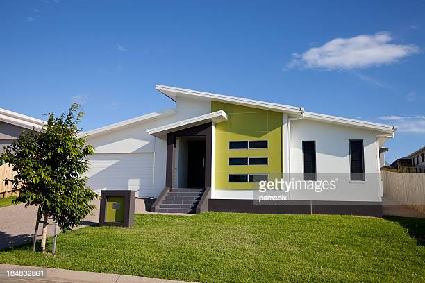 Front view of neat retro-modern family home