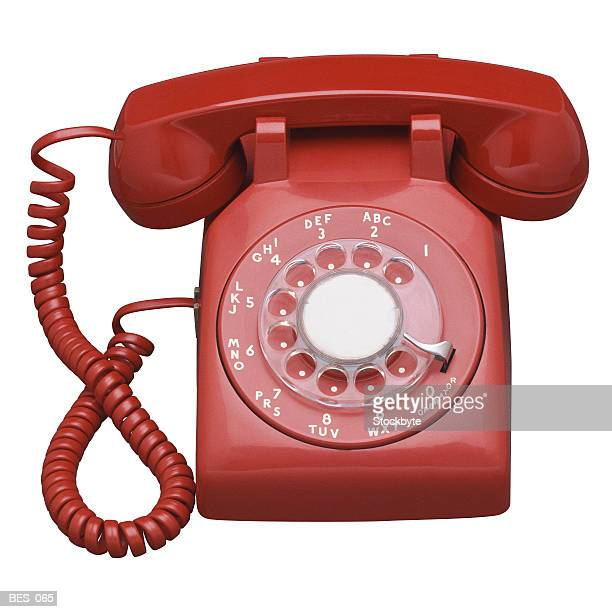 Front view of red rotary telephone