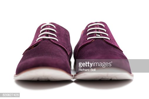 Front view of suede shoes on a white background
