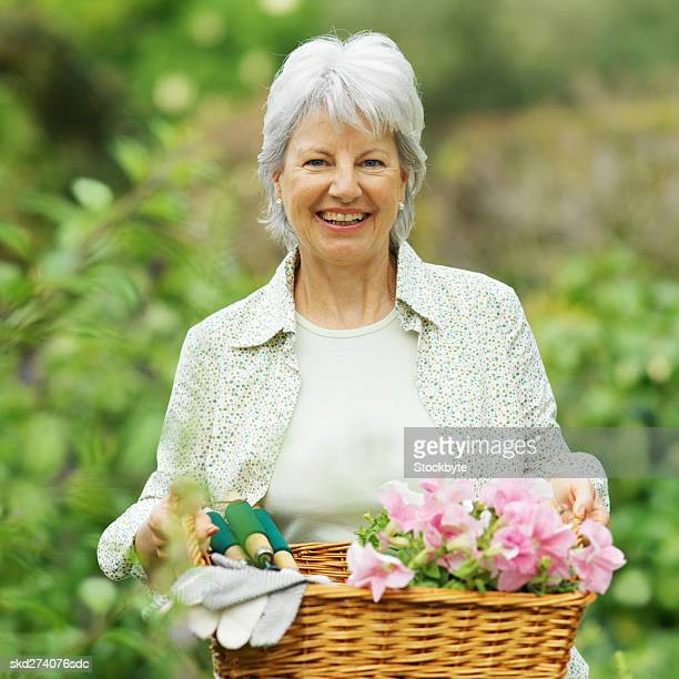 Front view of woman holding basket of flowers