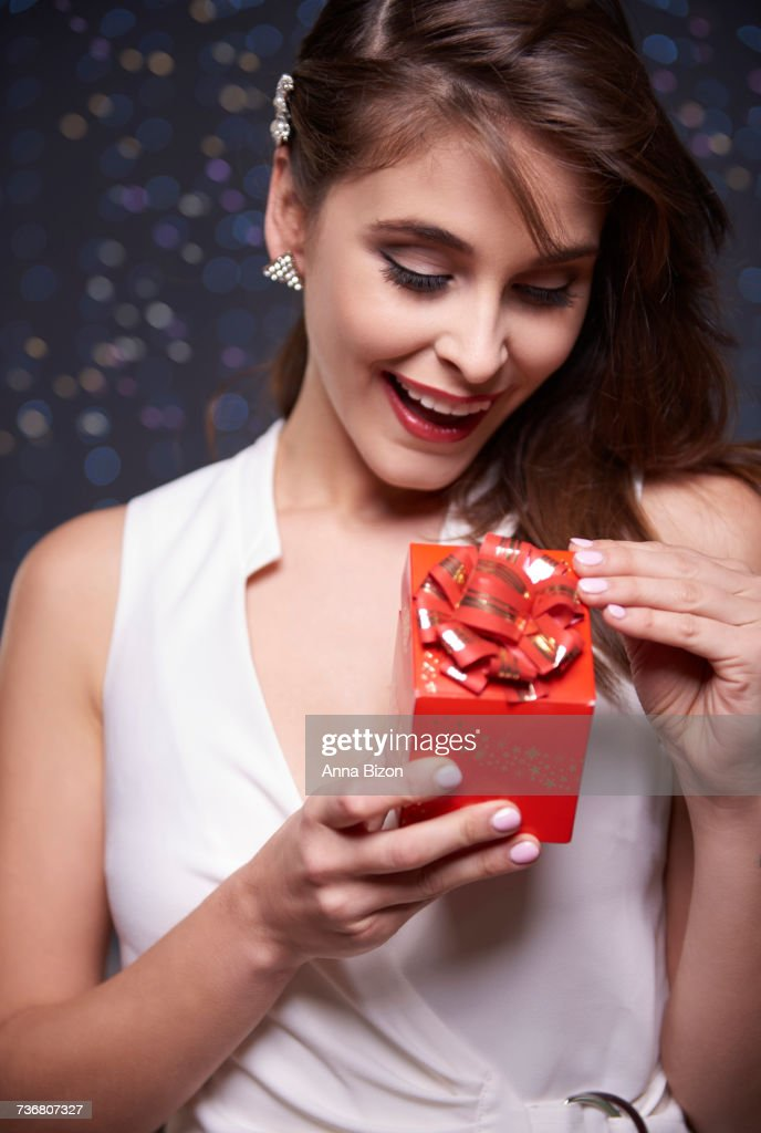 Front view of woman with present. Debica, Poland : Stock Photo