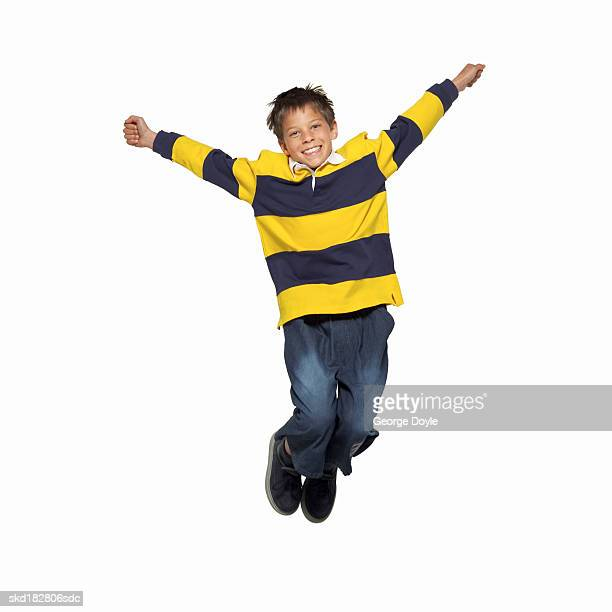 front view portrait of a boy (11-12) jumping on trampoline