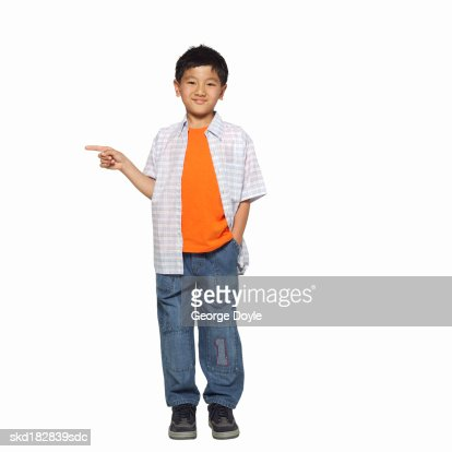 front view portrait of a boy (10-11) pointing his finger : Stock Photo