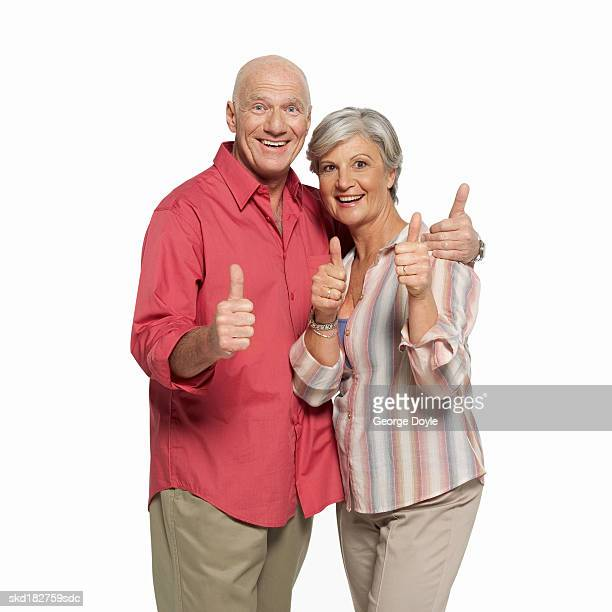 front view portrait of a man and woman giving the thumbs up