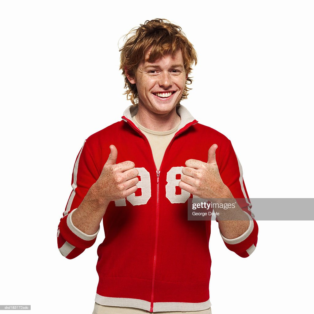 front view portrait of a man smiling giving the thumbs up : Stock Photo