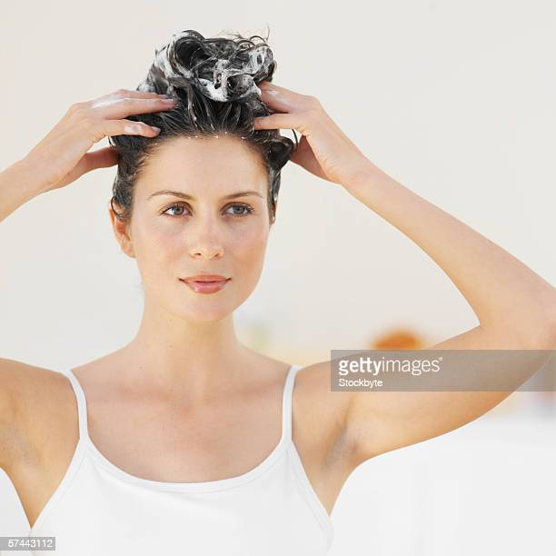 Front view portrait of a woman scrubbing her hair