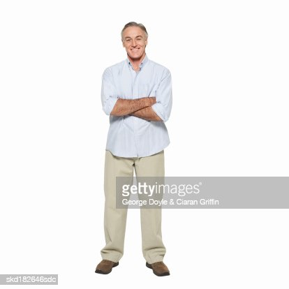 Front view portrait of mature man with arms crossed : Foto de stock