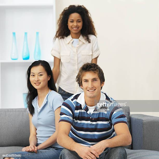 Front view portrait of three young people