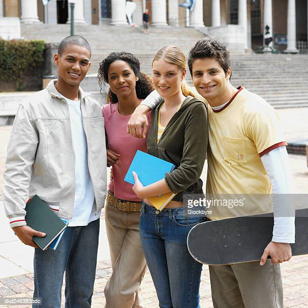 Front view portrait of young people standing outside college