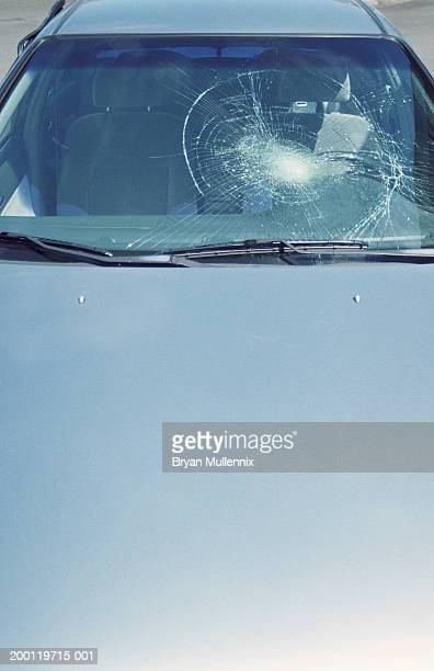 Front windshield of car, smashed, elevated view