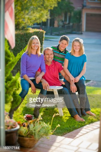 front yard family portrait of four : Stock Photo