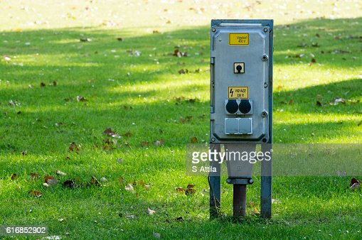 Frontal view of electric box in a park : Stock Photo