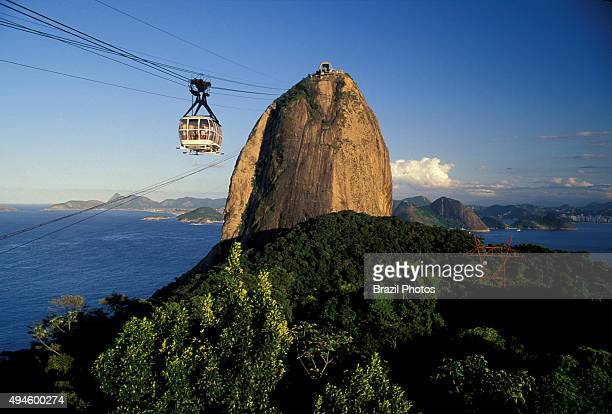 Frontal view of Sugar Loaf cable car and mountain urban forest entrance of Guanabara Bay Rio de Janeiro landmark Brazil