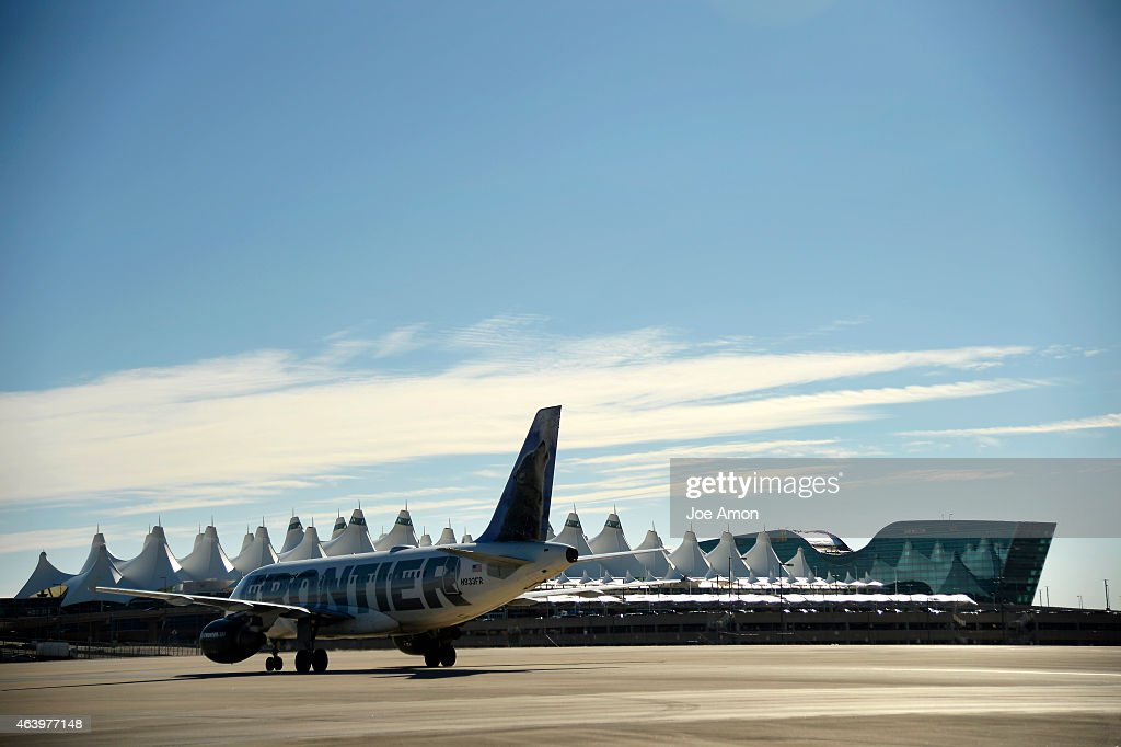 A Frontier Airlines flight heading to the concourse after landing at the Denver International Airport February 20 2015 Denver CO