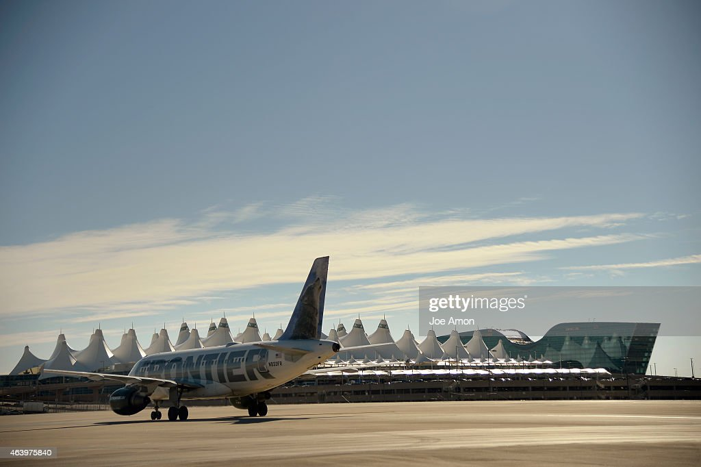A Frontier Airlines flight heading to the concourse past the 'tents' and Denver Airport Westin after landing at the Denver International Airport...