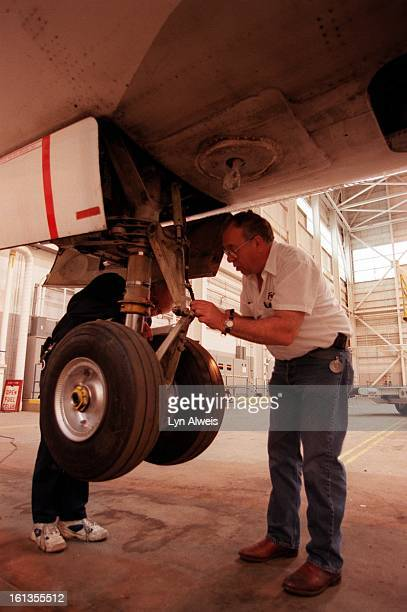 Frontier's maintence of a jet Using hydraulic jack to lift the entire plane to do a landing gear retraction check