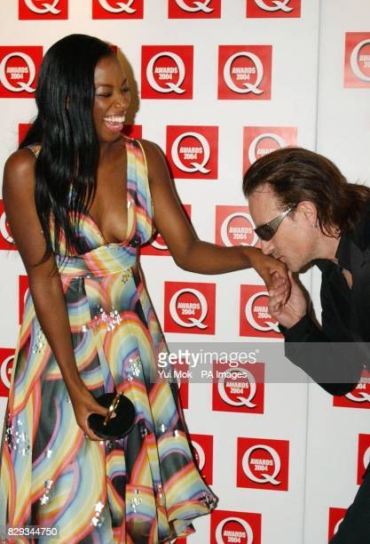 U2 frontman Bono gives singer Jamelia a kiss after she receives the Best Single award for 'See It In A Boy's Eyes' during the 15th annual Q Awards at...