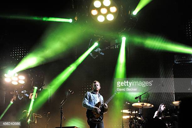 Frontman Caleb Followill and drummer Nathan Followill of Kings of Leon perform during the band's Mechanical Bull tour at the MGM Resorts Village on...