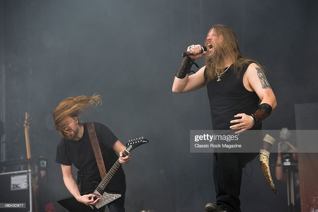 Frontman Johan Hegg (R) and guitarist Johan Soderberg of Swedish death metal group Amon Amarth performing live on the Zippo Encore Stage at Download Festival on June 16, 2013.