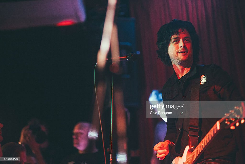 Frontman, lead guitarist and songwriter of US punk rock band Green Day, <a gi-track='captionPersonalityLinkClicked' href=/galleries/search?phrase=Billie+Joe+Armstrong&family=editorial&specificpeople=201545 ng-click='$event.stopPropagation()'>Billie Joe Armstrong</a> plays to packed out pub on February 20, 2014 in Sydney, Australia. Green Day, in Australia on the Soundwave Festival tour decided last minute to do a pub show at the Captain Cook Hotel in Surry Hills, Sydney. Playing on mostly borrowed gear, Green Day played to an intimate crowd.