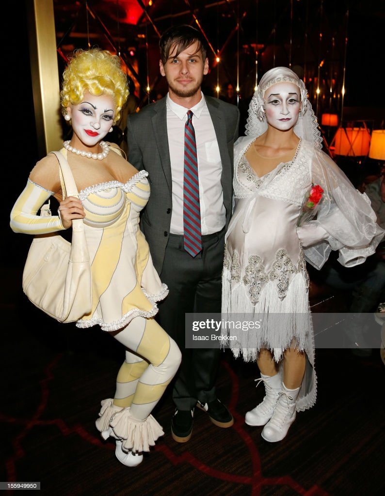 Frontman Mark Foster of the band Foster the People appears with 'Zarkana by Cirque du Soleil' characters at the reception for the Las Vegas premiere...