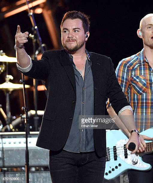 Frontman Mike Eli of the Eli Young Band performs onstage during ACM Presents Superstar Duets at Globe Life Park in Arlington on April 17 2015 in...