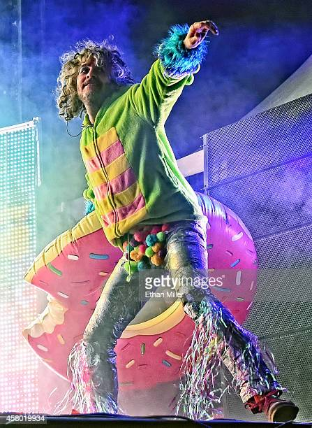 Frontman Wayne Coyne of The Flaming Lips throws an inflatable doughnut to the crowd as he performs during the Life is Beautiful festival on October...