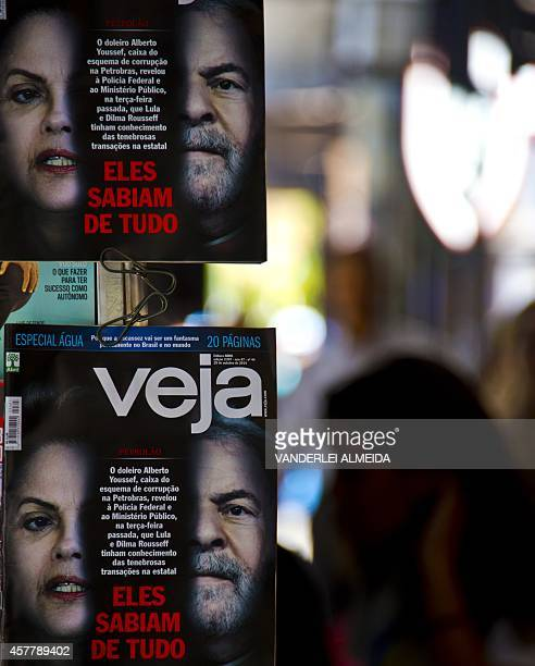 Frontpages of Brazilian magazine Veja are seen in Rio de Janeiro on October 24 2014 Veja reports about new revelations on Petrobras corruption affair...